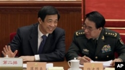 Bo Xilai, left, Chongqing's disgraced Communist Party leader, chats with Xu Caihou, vice chairman of China's Central Military Commission, at the People's Political Consultative Conference in the Great Hall of the People in Beijing, China, March 3, 2010.
