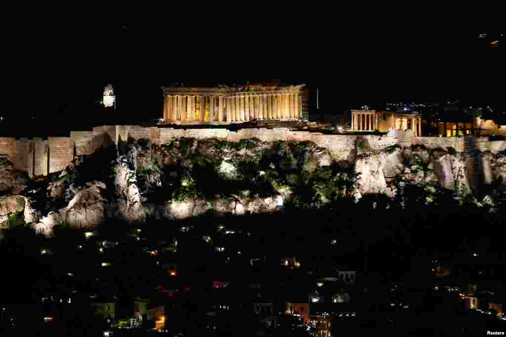 The ancient Parthenon temple is pictured atop the Acropolis hill before Earth Hour in Athens, Greece, March 30, 2019.
