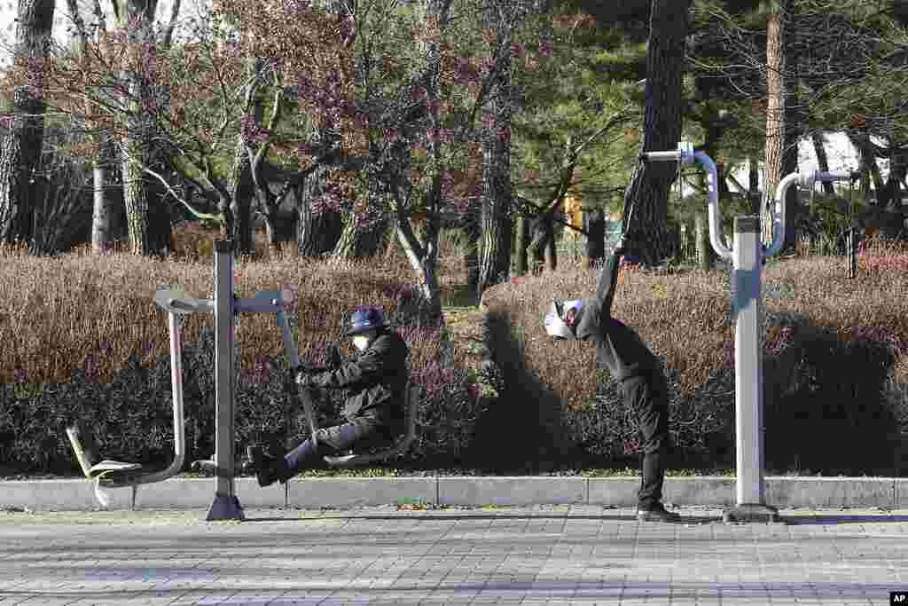 People wearing face masks as a precaution against the coronavirus exercise at a park in Goyang, South Korea.