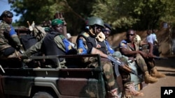 The Malian army patrol the streets of Gao, Northern Mali, Sunday Nov. 24, 2013. Malians have begun voting in legislative elections amid heavy security highlighting fears the poll could be sabotaged by rebel attacks. (AP Photo/Jerome Delay)