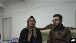 Iranian Sakineh Mohammadi Ashtiani, left, who has been sentenced to death by stoning for adultery, meets with her son, Sajjad, in the northwestern city of Tabriz, Iran, Saturday, Jan. 1, 2011. Ashtiani's sentence of death by stoning, which Iran has put on