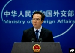 FILE - Foreign Ministry spokesman Hong Lei speaks during a press briefing in Beijing, China.