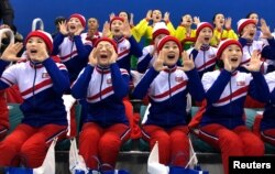 North Korean cheerleaders watch a women's ice hockey match between Korea and Japan in Gangneung, South Korea, February 14, 2018.