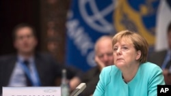 FILE - German Chancellor Angela Merkel during the opening ceremony of the G20 Leaders Summit in Hangzhou, Sept. 4, 2016. She says she's not happy about the possible demise of the Trans-Pacific Partnership trade agreement.