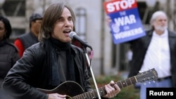 FILE - Singer-songwriter Jackson Browne performs at an Occupy DC rally in Washington's Freedom Plaza, Dec. 5, 2011.