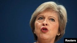 British Prime Minister Theresa May speaks on the final day of the annual Conservative Party Conference in Birmingham, England, Oct. 5, 2016.