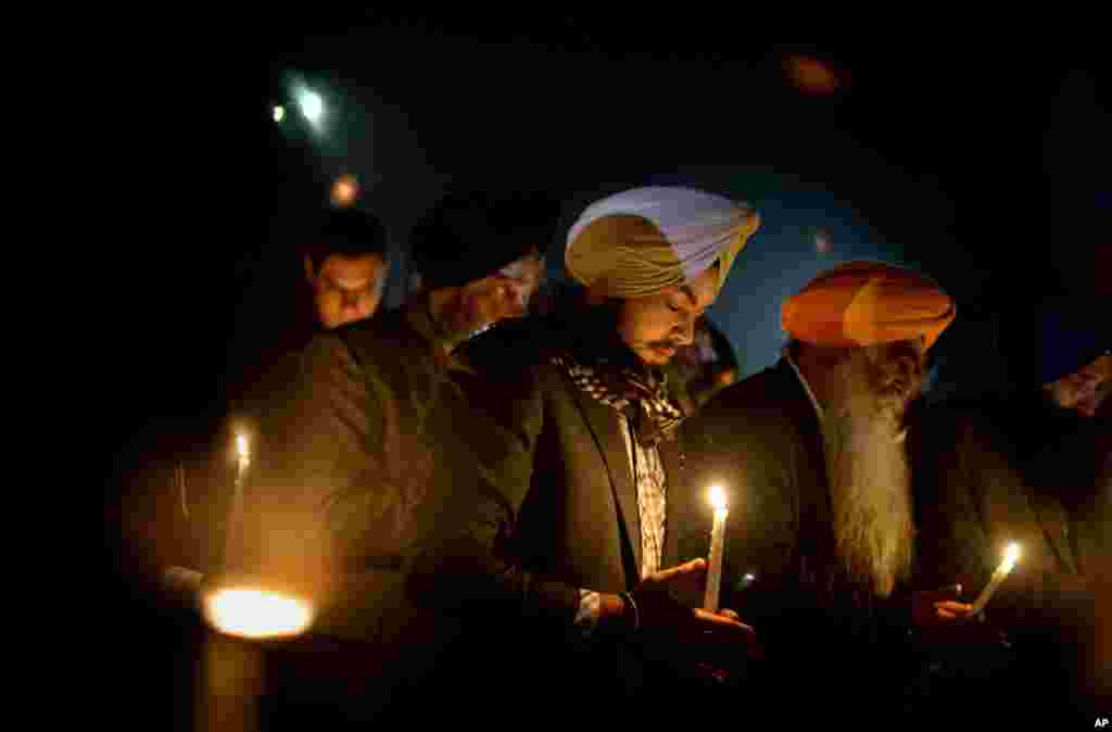 Varinder Singh, of the Queens borough of New York, joins a group of Sikhs from around the Northeastern U.S., in a moment of prayer as a memorial service is broadcast over a loudspeaker outside Newtown High School, December 16, 2012.
