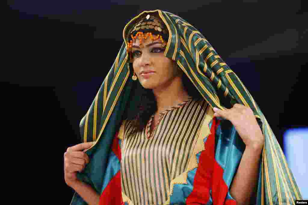 A model presents a Bedouin dress creation by Society for the Development and Rehabilitation for the Rural Woman (SDRRW), during their show in Amman November 8
