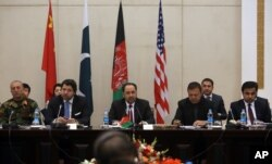 FILE - Afghan Foreign Minister, Salahuddin Rabbani, center, starts the meeting to discus a road map for ending the war with the Taliban at the Presidential Palace in Kabul, Afghanistan, Jan. 18, 2016.