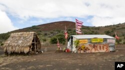 FILE - The base camp for protesters of the Thirty Meter Telescope project occupies a site near the summit of Mauna Kea, Aug. 31, 2015. Hawaii's land board on Thursday granted a construction permit for a giant telescope on a mountain that Native Hawaiians consider sacred, a project that has divided the state.