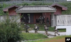 """FILE - In this Sept. 19, 2017, photo, U.S. Army soldiers from the 2nd Infantry Division's 2nd Armored Brigade Combat Team move during a joint military exercise between the U.S. and South Korea in Pocheon, South Korea. A South Korean lawmaker said Oct. 10, 2017, that North Korean hackers may have stolen highly classified military documents that include U.S.-South Korean wartime """"decapitation strike"""" plans against the North, according to South Korean media reports."""