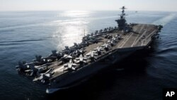 In this Nov. 12, 2011 photo provided by the U.S. Navy, the Nimitz-class aircraft carrier USS John C. Stennis (CVN 74) transits the Straits of Hormuz.
