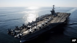 FILE - In this Nov. 12, 2011 photo provided by the U.S. Navy, the Nimitz-class aircraft carrier USS John C. Stennis (CVN 74) transits the Straits of Hormuz.