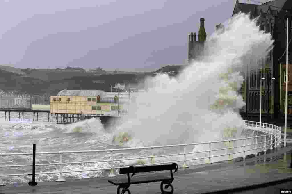 A large wave crashes over the promenade in Aberystwyth, mid Wales, Britain.