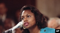 FILE - University of Oklahoma law professor Anita Hill testifies before the Senate Judiciary Committee on Capitol Hill, Oct. 11, 1991.
