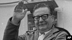 FILE - In this 1971 file photo, President Salvador Allende waves to supporters in Chile