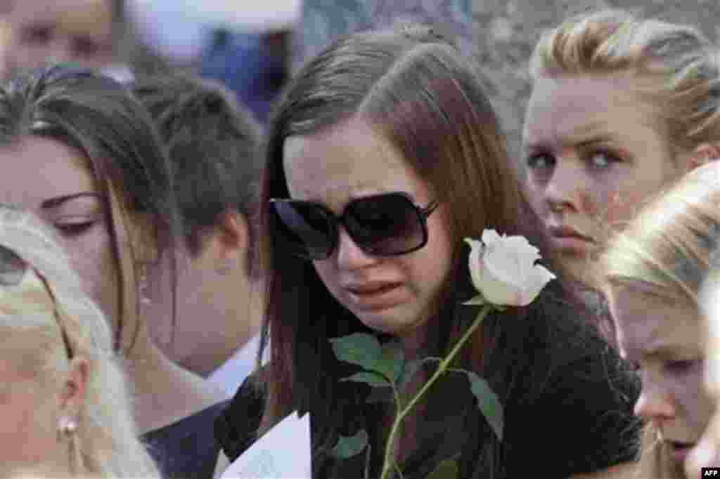 A mourner weeps during the funeral service for Bano Abobakar Rashid, 18, the first victim of the shooting rampage at Utoeya to be buried, at a church in Nesodden, near Oslo, Norway, Friday July 29, 2011. Rashid, whose family fled to Norway from Iran in