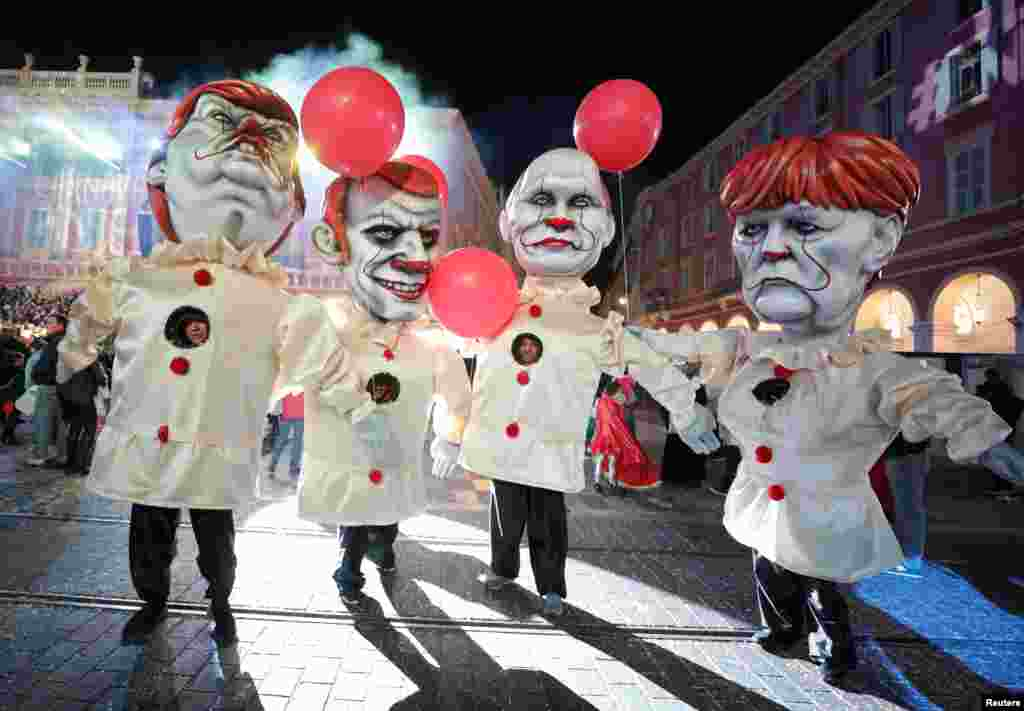Giant figures of French President Emmanuel Macron, German Chancellor Angela Merkel, U.S. President Donald Trump and Russian President Vladimir Purin are seen during the 135th Carnival parade in Nice, France.