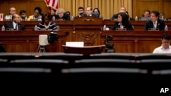 The witness chair reserved for Attorney General William Barr sits empty as Chairman Jerrold Nadler, D-N.Y., center background, gives his opening statement at a House Judiciary Committee hearing on Capitol Hill in Washington, May 2, 2019.