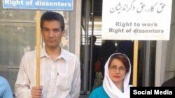 In this undated photo shared on social media, Iranian rights activist and physician Farhad Meysami attends a protest alongside his friend and human rights lawyer, Nasrin Sotoudeh.