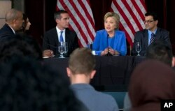 FILE - Democratic presidential candidate Hillary Clinton participates in a roundtable with Muslim community leaders at the University of Southern California in Los Angeles, March 24, 2016.