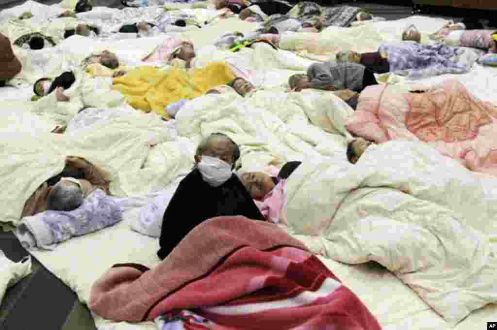 People, who are evacuated from a nursing home which is located in evacuation area around the Fukushima Daini nuclear plant, rest at a temporary shelter in Koriyama. (Reuters Image)