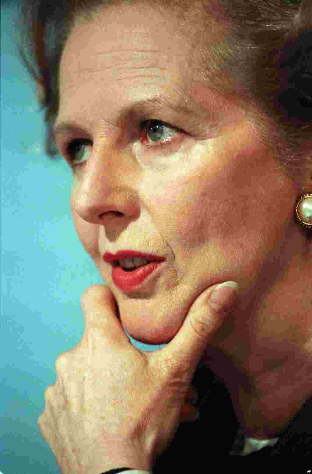 Then Prime Minister Margaret Thatcher took a moment for thought during a press conference in central London, June 10, 1987.
