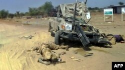 Bodies appearing to be those of rebel-soldiers allied to former vice president Riek Machar beside wrecked military vehicle, Bor, Dec. 28, 2013.