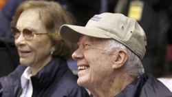Former President Jimmy Carter and wife Rosalynn Carter get ready to lead Habitat for Humanity volunteers in Washington earlier this month