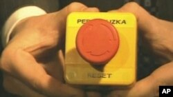 "Russian Foreign Minister Sergei Lavrov holds a ""reset"" button given to him by Secretary of State Hillary Clinton"