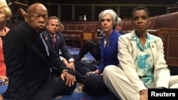 A photo tweeted from the floor of the U.S. House by Rep. Donna Edwards (R) shows Democratic members of the U.S. House of Representatives, including herself and Rep. John Lewis (L) staging a sit-in on the House floor. (REUTERS/Rep. Donna Edwards/Handout)