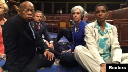 U.S. House Democrats including John Lewis, left, and Donna Edwards, right, stage a sit-in to demand action on gun legislation. Edwards tweeted the photo.