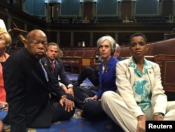A photo tweeted from the floor of the U.S. House by Rep. Donna Edwards (R) shows Democratic members of the U.S. House of Representatives, including herself and Rep. John Lewis (L) staging a sit-in on the House floor.