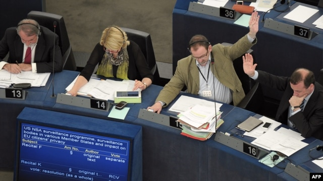 Members of the EU Parliament take part in a voting session on the implications for EU citizens' privacy of the US Prism and other internet surveillance cases, on July 4, 2013 during a session of the European Parliament in Strasbourg, eastern France.
