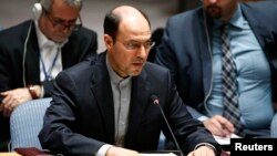 "FILE - Hossein Dehghani, Iran's deputy U.N. representative who is shown addressing the Security Council in July 2014, says a resolution condemning Iran for rights violations is a ""selective and politicized distortion of facts."""