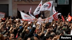 Members of the Tunisian General Labour Union mark International Workers' Day, Tunis, May 1, 2012.