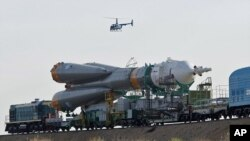 Russian Soyuz TMA-02M space ship that will carry new crew to the International Space Station, ISS, is transported from hangar to the launch pad at the Russian leased Baikonur cosmodrome, Kazakhstan (File Photo - June 5, 2011)