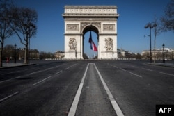 A french flag is under the Arc de Triomphe, on March 19, 2020 in Paris, as a strict lockdown is in effect in France to stop the spread of COVID-19, caused by the novel coronavirus.