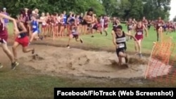High school runners jump into a mud pit during a recent event in Texas.