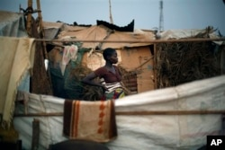 FILE - Christian refugees create a home for themselves in makeshift shelters near the airport in Bangui, Central African Republic, Jan. 28, 2014.