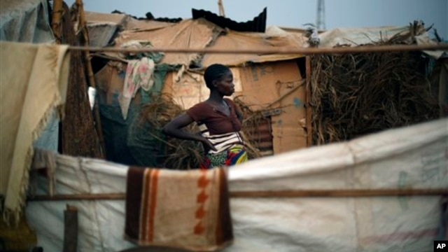 Christian refugees create a home for themselves in makeshift shelters near the airport in Bangui, Central African Republic, Tuesday Jan. 28, 2014, as they try to escape from the deepening divisions between the country's Muslim minority and Christian major
