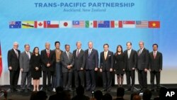 Trade delegates appear after signing the Trans-Pacific Partnership agreement in Auckland, New Zealand in February.