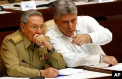 FILE - In this July 6, 2013 file photo, Cuba's President Raul Castro, left, and Vice President Miguel Diaz-Canel Bermudez attend the opening of a two-day, twice-annual legislative sessions, at the National Assembly in Havana, Cuba