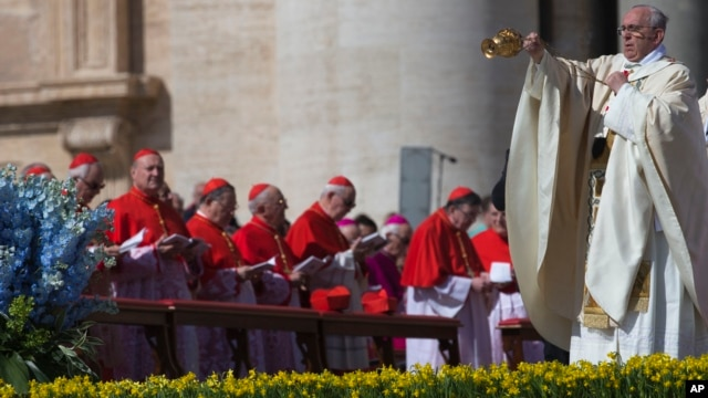 Pope Francis incenses the faithful as he arrives to celebrate an Easter Sunday Mass in St. Peter's Square at the Vatican Sunday, April 20, 2014.