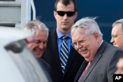 US Secretary of State Rex Tillerson, left, and U.S. Ambassador to Russia John Tefft arrive at Moscow's Vnukovo airport, Russia, April 11, 2017.
