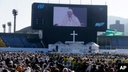 Pope Francis celebrates a Mass at Nagasaki Prefectural Baseball Stadium, Sunday, Nov. 24, 2019, in Nagasaki, Japan.