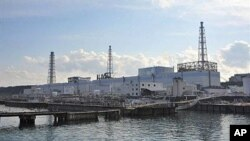 The badly damaged Tokyo Electric Power Co (TEPCO) Number 1 Daiichi nuclear power plant at Okuma town in Fukushima prefecture, March 31, 2011
