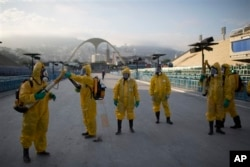 Health workers get ready to spray insecticide to combat the Aedes aegypti mosquitoes that transmit the Zika virus under the bleachers of the Sambadrome in Rio de Janeiro in January 2016. (AP Photo/Leo Correa)