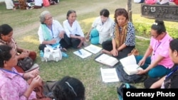 Im Chaem, center, wearing a white shirt sits with a group of women in a Bible study session, Battambang province, Cambodia, January 22, 2018. (Courtesy photo of pastor Touch Chanthou)
