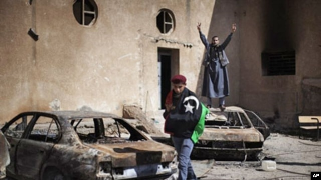 Libyan anti-regime demonstrators at a burned police station in Tobruk, February 25, 2011